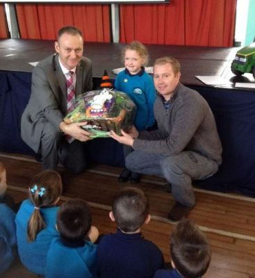 Mr Baldrick and Michael presenting Olivia in P2 with her PTA Hamper.